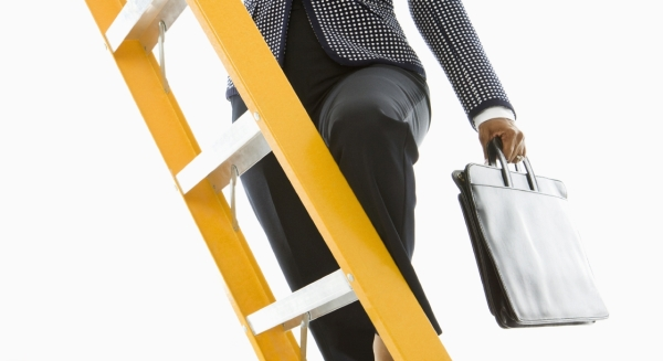 Businesswoman-climbing-ladder-cropped